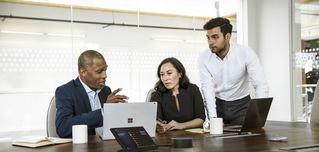 Picture of a team of people working together using Microsoft products | From Microsoft Image Library